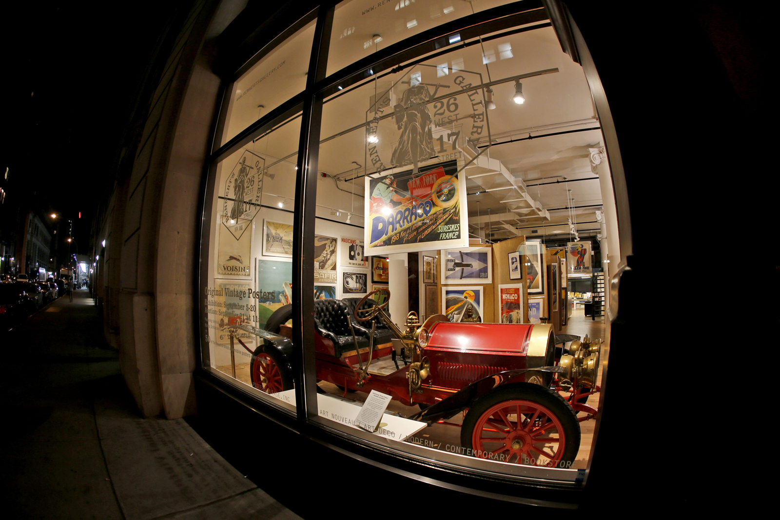 An Antique Car Displayed at the Gallery